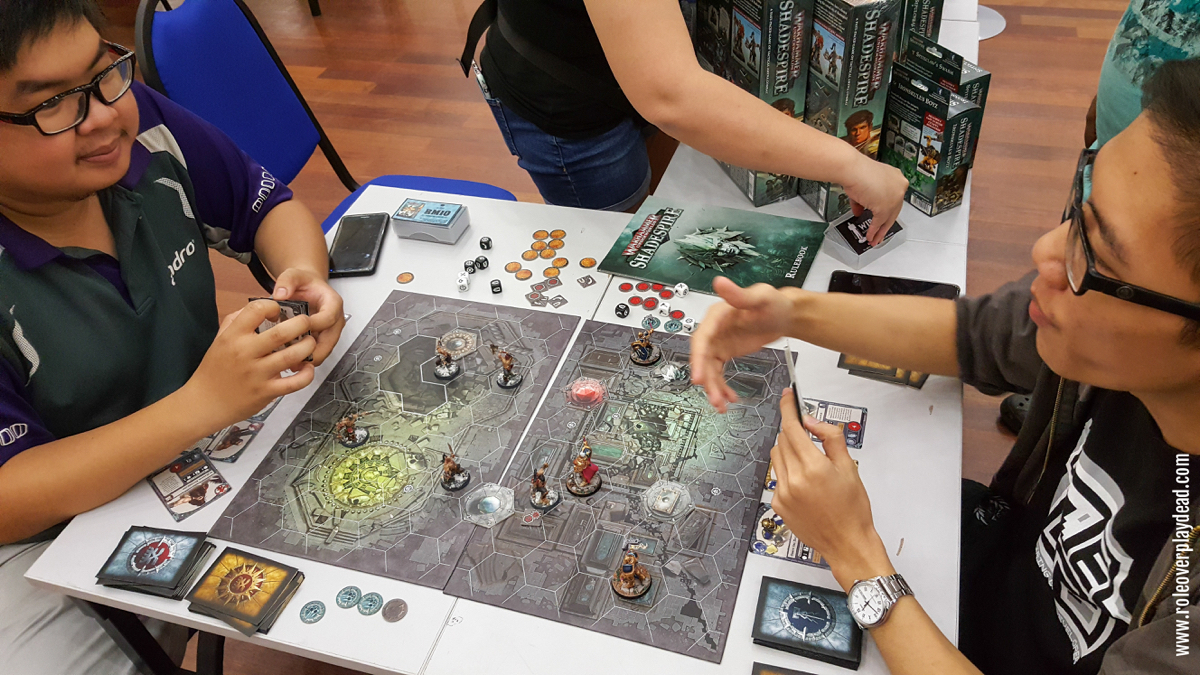 Playing the Shadespire board game.