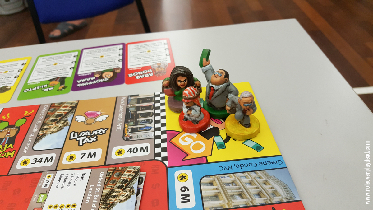 Specially-painted figures in this demonstration set of Kleptopoly, a local board game by C4 Centre.